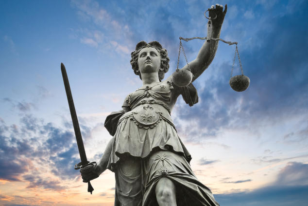 justice statue with sword and scale. cloudy sky in the background.; Shutterstock ID 50000521; PO: Rhea Medium EO litigation; Client: NRDC